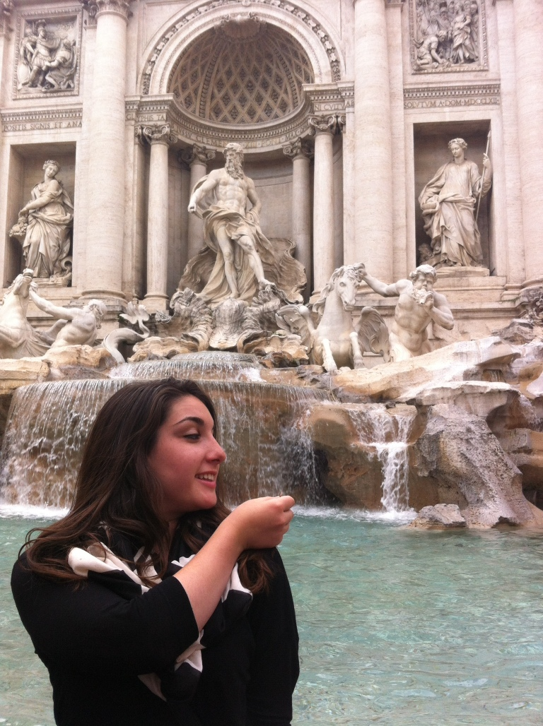 Making a wish with a coin into the Trevi Fountain