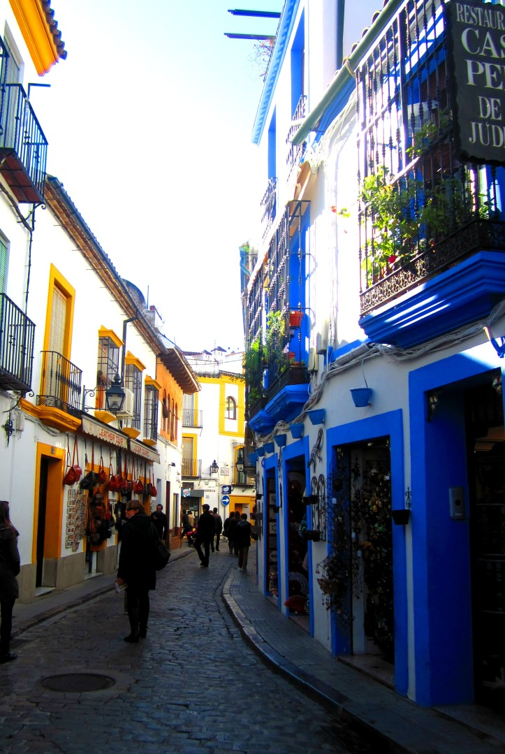 White washed and paint splattered side street in Córdoba, Spain.